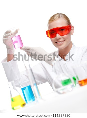 Pretty doctor in spectacles keeps a beaker with purple water, isolated on white