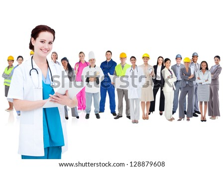 Pretty doctor standing in front of diverse career group on white background - stock photo