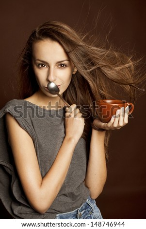 Pretty dreamy young girl drinks coffee  - stock photo