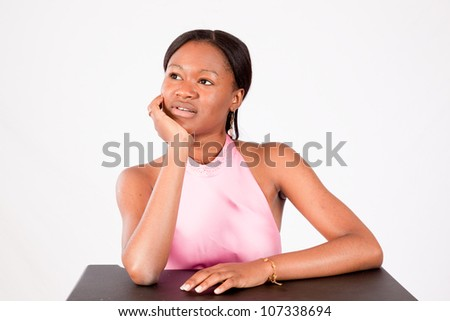 Pretty ethnic woman in a pink formal dress with a friendly, happy smile