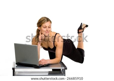 Pretty exciting woman eyes closed with pleasure, working with laptop - stock photo
