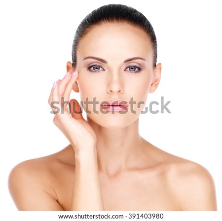 Pretty face of  a beautiful  woman who touching skin  near eyes  - isolated on white - stock photo