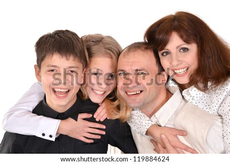 Pretty family posing on a white background