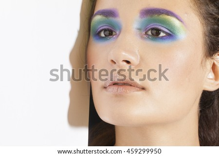 pretty fashion model girl with colorful make up close up