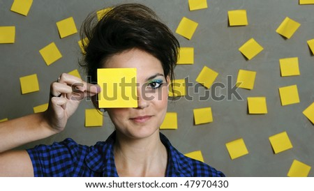 Pretty fashion model with hundreds of post it notes