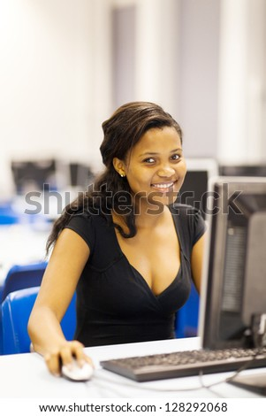 pretty female african american university student in computer room - stock photo