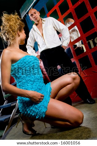 Pretty female and male models at night club interior - stock photo