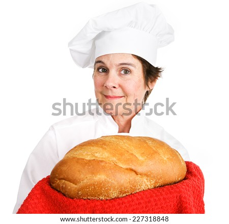 Pretty female bakery chef holding a loave of freshly baked bread, golden brown and crusty.  Isolated on white background.   - stock photo