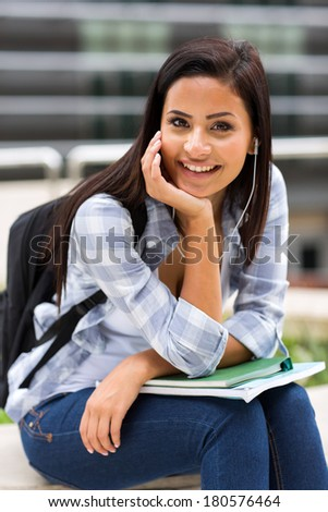 pretty female college student on campus - stock photo