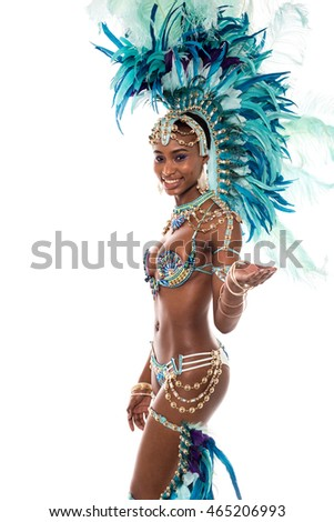 Pretty female dancer pointing showing palm to camera.