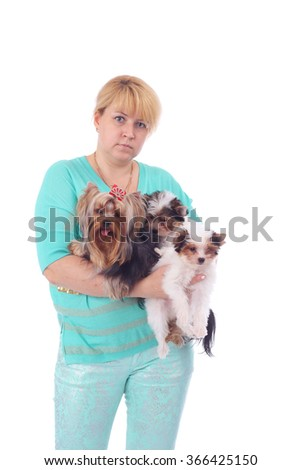 pretty female dog breeder with her dogs