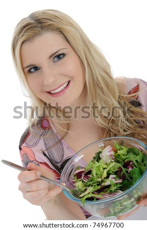 Pretty female eating green vegetable salad. isolated on white - stock photo