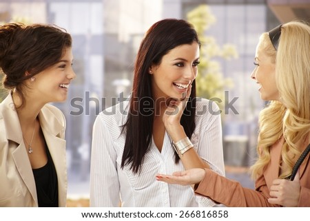 Pretty female friends chatting, smiling happy outdoors. - stock photo