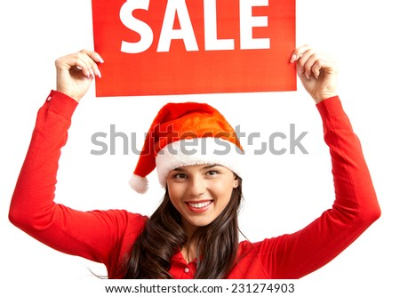 Pretty female in Santa cap inviting you for xmas sale