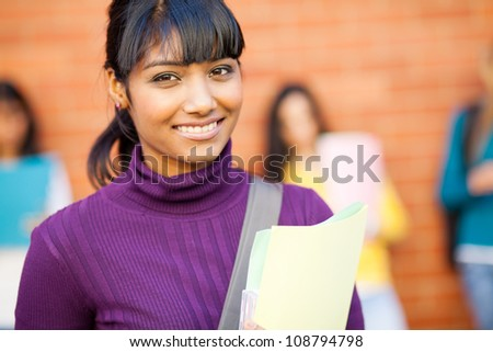 pretty female indian college student portrait - stock photo