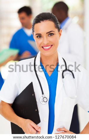 pretty female medical worker in front of colleagues