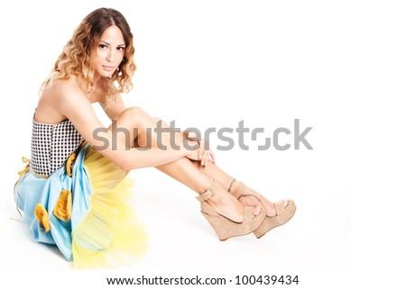 pretty female model in summer dress full body shot sit studio shot white - stock photo