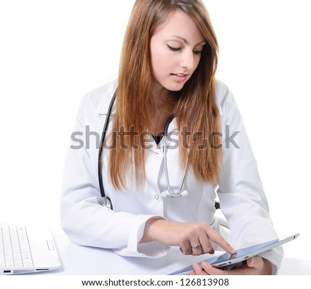Pretty female student doctor working with an digital tablet - stock photo