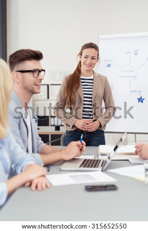 Pretty Female Team Leader Listening to her Colleague Talking While Having a Meeting Inside the Boardroom. - stock photo