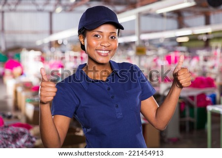 pretty female textile worker with thumbs up