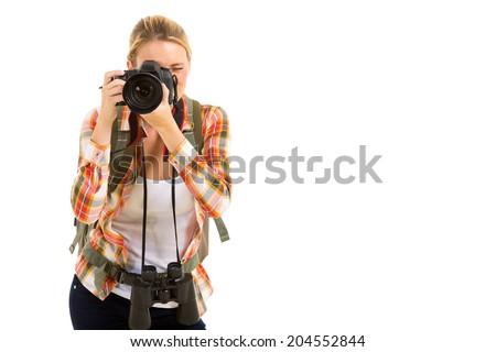 pretty female traveller using digital camera taking photos - stock photo