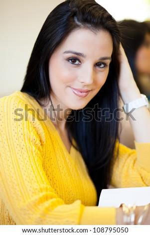 pretty female university student in classroom - stock photo