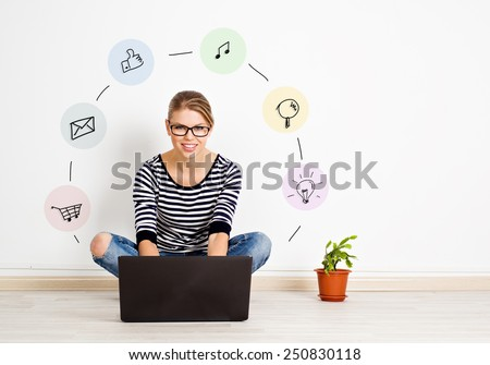 Pretty female with computer sitting at home with social icons around. Concept of internet marketing and media.   - stock photo