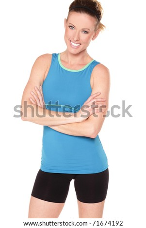 Pretty fitness model with arms crossed on white background - stock photo