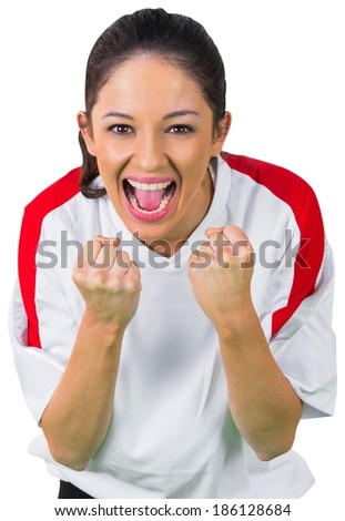 Pretty football fan in white cheering on white background - stock photo