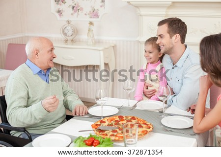 Pretty friendly family is dining in cafe - stock photo