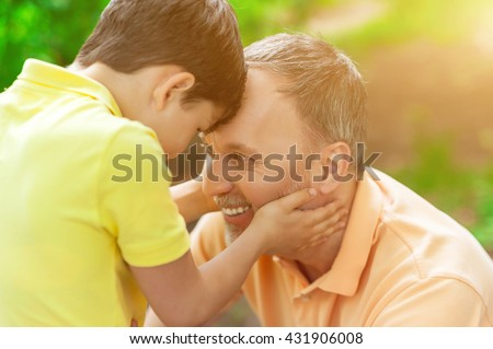 Pretty friendly family is enjoying time together - stock photo