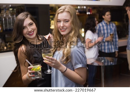 Pretty friends having a drink together at the bar