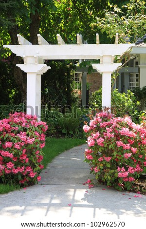 Pretty garden arbor with pink flowers. Also available in horizontal.