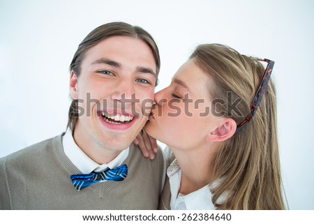 Pretty geeky hipster giving boyfriend kiss on the cheek on white background - stock photo