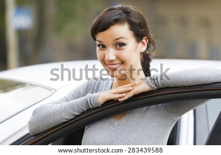 Pretty girl and white car - stock photo
