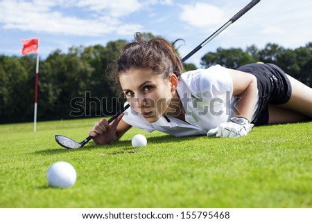 Pretty girl cheating on golf field, tried to blow the ball