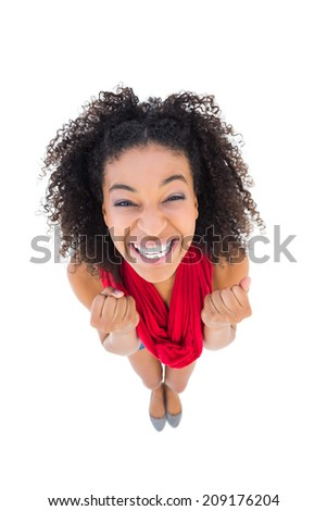 Pretty girl cheering at camera on white background - stock photo