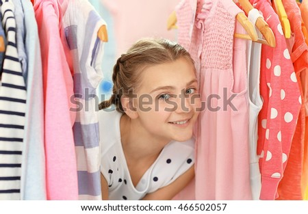 Pretty girl choosing clothes