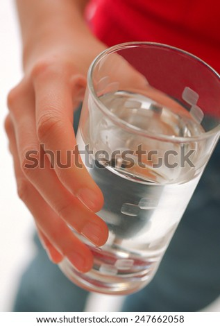 pretty girl drinking water from glass - stock photo