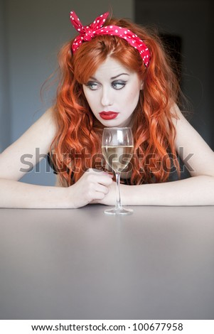 Pretty girl drinking wine - stock photo