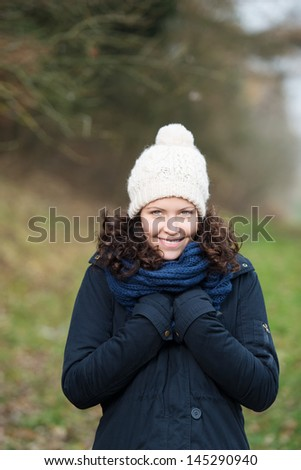 Pretty girl during a winter walk dressed in warm clothes - stock photo