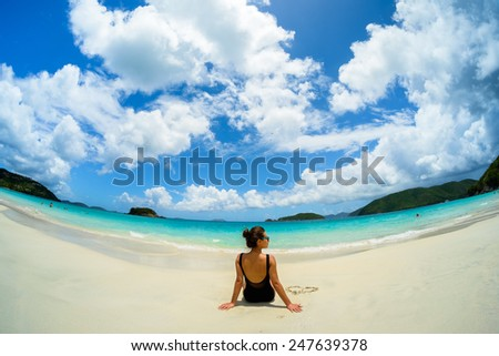 Pretty girl enjoying a beautiful Carribean beach in Saint John in the United States Virgin Islands. - stock photo