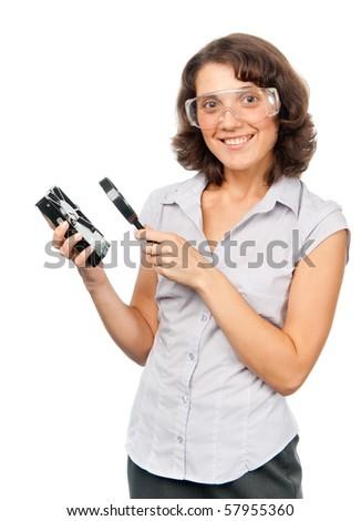 Pretty girl examines a hard drive - stock photo