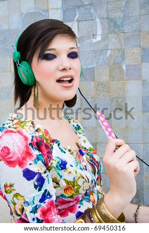 pretty girl excited about music - stock photo