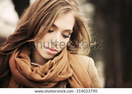 Pretty Girl Fashion Model Outdoors. Autumn Background - stock photo