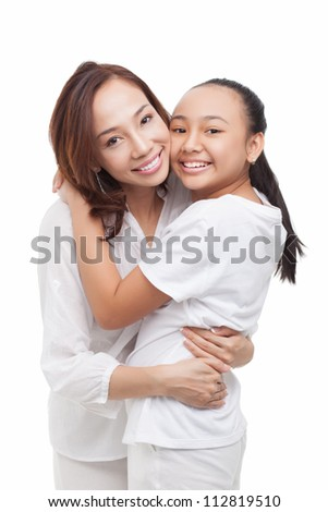 Pretty girl giving her mom a loving hug - stock photo