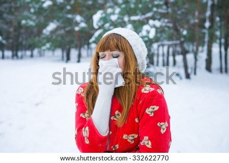 Pretty girl has flu and fever in winter day outdoor. seasonal colds. Flu winter - stock photo