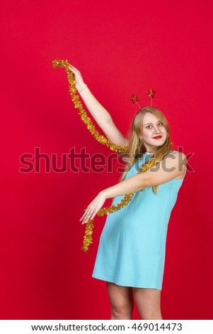 Pretty girl having fun on a christmas party