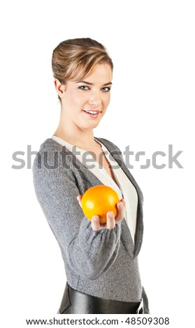 Pretty girl hold an orange in her hand; isolated on white background - stock photo