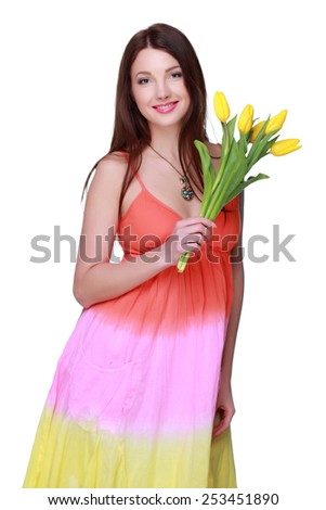 Pretty girl holding a bouquet of fresh flowers on Holiday